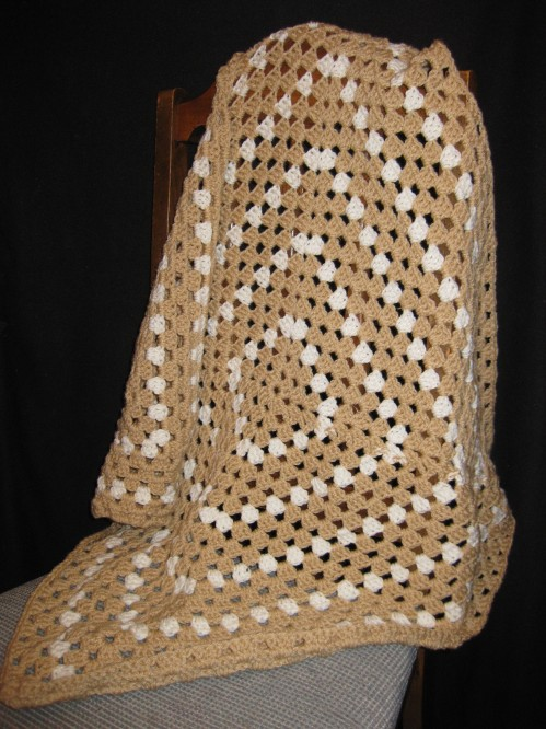 Small, continuous Granny Square Blanket. Tan and Cream. Perfect size for a doll bed or a bassinet. $20