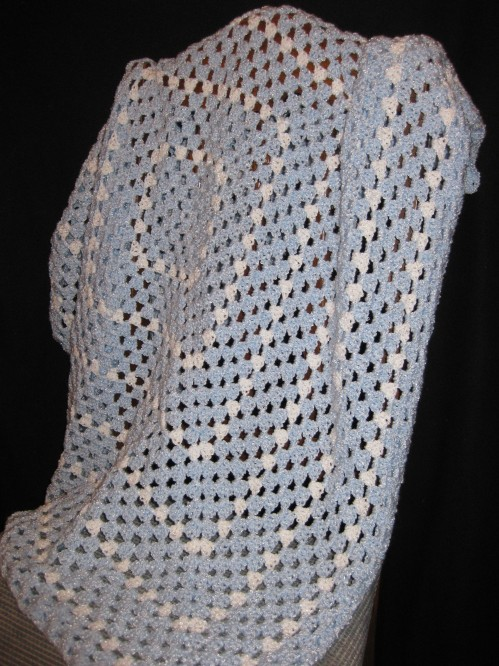Large, continuous Granny Square Blanket. Pale blue and white. $30
