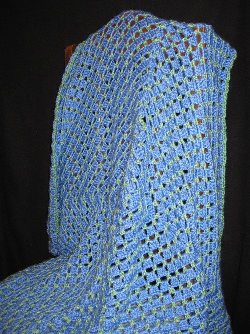 Large, continuous Granny Square Blanket with a small green row in between the blue rows. Blue and green. $30.