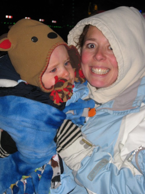 Mommy and Caleb snuggles. Caleb was all smiles for the camera and loved watching the lights on the train.