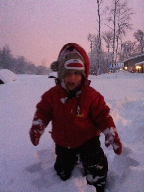 Noah trudging through the snow. He was struggling. The snow was so deep and his little legs are short.