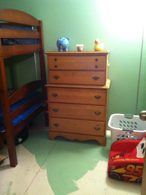 Noah's dresser - he can reach the bottom three drawers and pull out the bottom two drawers.