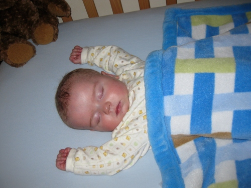 6 days after open-heart surgery and he's sleeping with his arms over his head.
