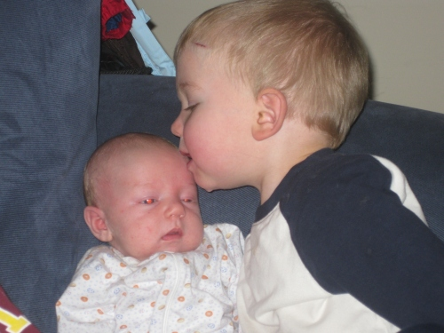 Eli loves his baby brother, Noah.