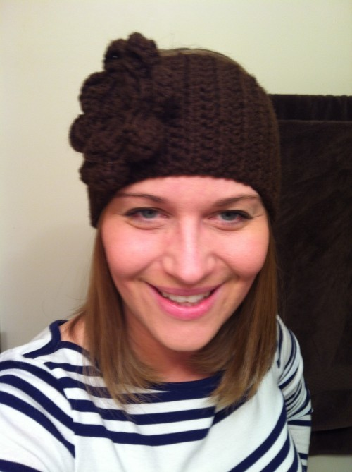 Ear Warmer - with a large flower and two buttons for adjustable sizes.